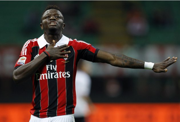 AC Milan's Muntari celebrates after scoring against Atalanta during their Italian Serie A soccer match in Milan