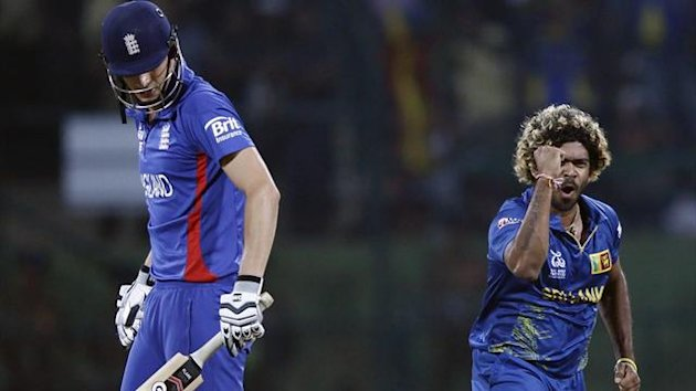 Sri Lanka's Lasith Malinga celebrates taking the wicket of England's Alex Hales (L) during their Twenty20 World Cup Super 8 cricket match in Pallekele October 1, 2012 (Reuters)