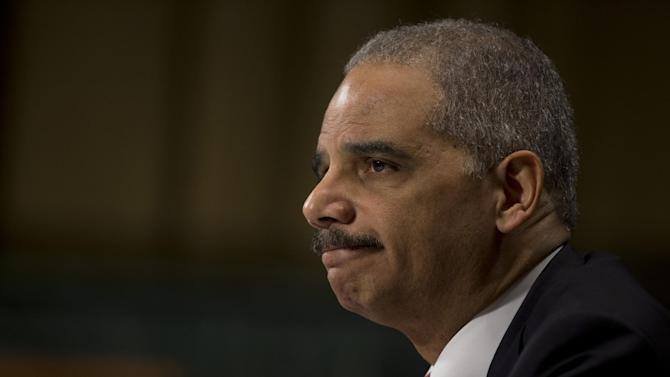 """Attorney General Eric Holder pauses as he testifies on Capitol Hill in Washington, Wednesday, March 6, 2013, before the Senate Judiciary Committee hearing: """"Oversight of the U.S. Department of Justice."""" Holder urged Congress to confront gun violence by requiring universal background checks, imposing tougher penalties on traffickers and banning high-capacity magazines and military-style assault weapons.  (AP Photo/Evan Vucci)"""