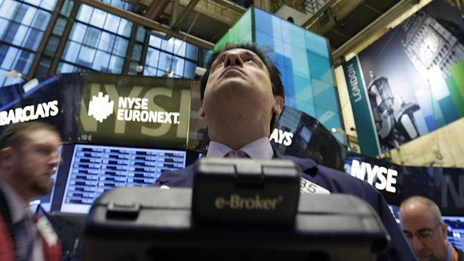 Traders work on the floor of the New York Stock Exchange Tuesday, Jan. 8, 2013. U.S. stocks opened mostly lower Tuesday as traders awaited the start of U.S. corporate earnings season. (AP Photo/Richard Drew)