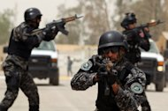 Students from the Iraqi Federal Police perform a demonstration drill during their graduation ceremony in Baghdad, May 3. The United States has reduced -- and may phase out entirely -- a multi-billion-dollar police training program that was to have been the centerpiece of a hugely expanded civilian mission in Iraq, The New York Times reported Sunday