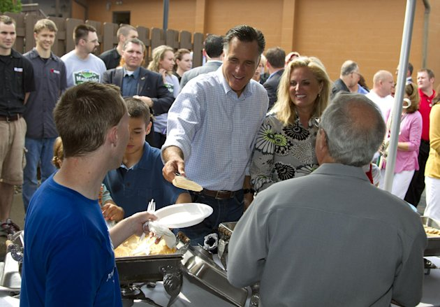 Republican presidential candidate, former Massachusetts Gov. Mitt Romney, left, serves pancakes with his wife Ann, during a campaign stop at Mapleside Farms Sunday, June 17, 2012, in Brunswick, Ohio. (AP Photo/Evan Vucci)