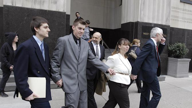 From left, Joshua Stone, David Stone Jr., Tina Stone and David Stone, Sr. leave the federal courthouse in Detroit, Thursday, March 29, 2012.  Stone Sr., a Michigan militia leader and his son, Joshua, each pleaded guilty Thursday to illegally possessing a machine gun, ending a six-week trial that took a dramatic turn this week when a judge dismissed more serious charges of conspiring to rebel against the government. (AP Photo/Carlos Osorio)