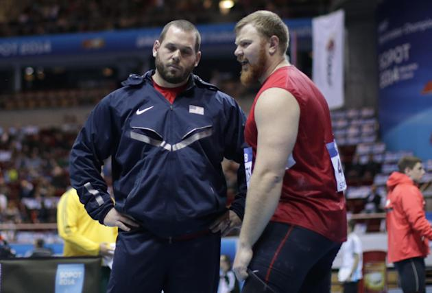 United States' Ryan Whiting, left, talks to his teammate Kurt Roberts during the qualification for the men's shot put during the Athletics World Indoor Championships in Sopot, Poland, Friday,