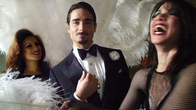 """FILE - In this Dec. 10, 2002 file photo, Kevin Richardson, 31, center, of the pop-singing group Backstreet Boys, poses with Michelle DeJean, left, and Donna Marie Asbury, both members of the Broadway musical """"Chicago"""", in New York. Richardson portrayed shady lawyer Billy Flynn. The matinee performance on Aug. 27, 2011 will mark the musical's 6,138 show, meaning it vaults over """"A Chorus Line"""" to become the fourth longest-running show in Broadway history.  (AP Photo/Bebeto Matthews)"""