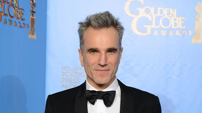 """Actor Daniel Day-Lewis poses with the award for best performance by an actor in a motion picture - drama for """"Lincoln"""" backstage at the 70th Annual Golden Globe Awards at the Beverly Hilton Hotel on Sunday Jan. 13, 2013, in Beverly Hills, Calif. (Photo by Jordan Strauss/Invision/AP)"""