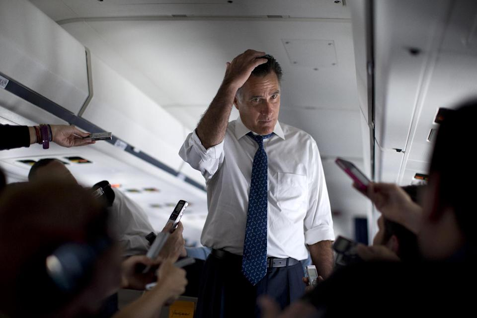 Republican presidential candidate, former Massachusetts Gov. Mitt Romney listens to a question as he speaks with the media aboard his campaign plane during a flight to Boston, Friday, Sept. 28, 2012.  (AP Photo/ Evan Vucci)