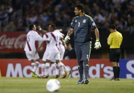 Argentina's goalkeeper Sergio Romero reacts to Peru's goal in their 2014 World Cup qualifying soccer match in Buenos Aires