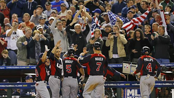 United States' David Wright is greeted at the dougout after hitting a grand slam in the fifth inning of a World Baseball Classic game against Italy Saturday, March 9, 2013, in Phoenix.(AP Photo/The Arizona Republic,  David Kadlubowski)  MARICOPA COUNTY OUT; MAGS OUT; NO SALES