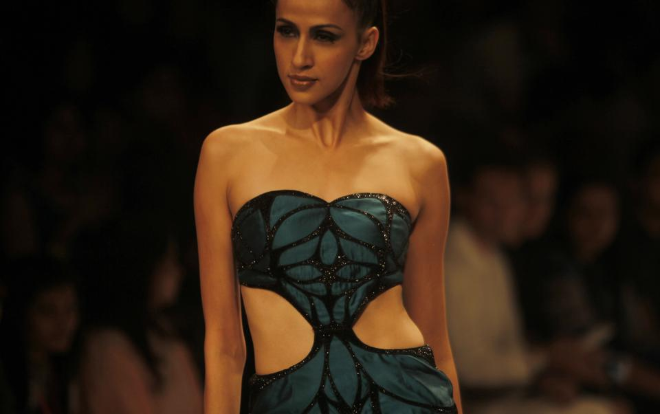 An Indian model displays a creation by Vizyon during the Lakme Fashion Week in Mumbai, India, Friday, Aug. 3, 2012. (AP Photo/Rafiq Maqbool)