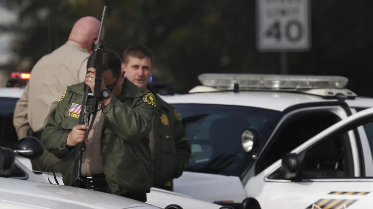 County sheriff's deputy stands guard near the area where a shooting