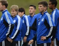 Schalke's Klaas-Jan Huntelaar (R) warms up during a training session on the eve of their Champions League match against Montpellier. Schalke will be looking for a second successive European win on the back of a poor performance in the German league