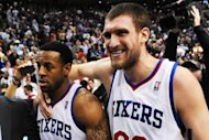 Andre Iguodala (L) and Spencer Hawes of the Philadelphia 76ers walk off the court after a 79-78 win over the Chicago Bulls in Game Six of the Eastern Conference Quarterfinals in the 2012 NBA Playoffs at the Wells Fargo Center, on May 10, in Philadelphia, Pennsylvania. The 76ers ousted the top-seeded Bulls and booked a 2nd round clash with the Boston Celtics