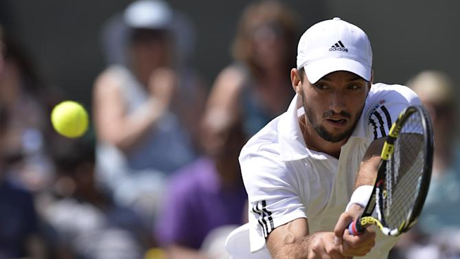 Serbia's Viktor Troicki returns against Russia's Mikhail Youzhny in their third round men's singles match at the 2013 Wimbledon Championships in southwest London on June 29, 2013
