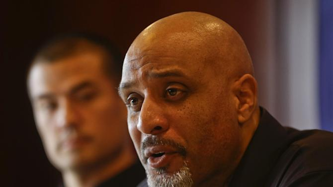 Tony Clark, the newly named Executive Director of the Major League Baseball Players Association, answers questions during a news conference at the organizations' annual meeting Tuesday, Dec. 3, 2013, in San Diego. Clark, who replaced the late Michael Weiner, is flanked by executive board member Jeremy Guthrie. (AP Photo/Lenny Ignelzi)