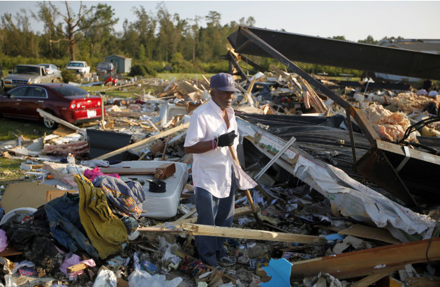 Henry Rhines tries to salvage anything he can from the debris field that was once his home in Columbia, N.C. on Tuesday, Aug. 30, 2011. A number of houses along U.S. 64 south of Columbia were destroye