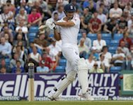 England&#39;s Alastair Cook hits a shot during day two of the second international Test cricket match between England and South Africa at Headingley Carnegie in Leeds. England were 48 for no wicket when bad light ended play with 22 overs still due to be bowled