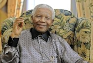 Nelson Mandela at a hotel in central London in 2008. Nelson Mandela was responding better to treatment in hospital early Wednesday, South African President Jacob Zuma told parliament