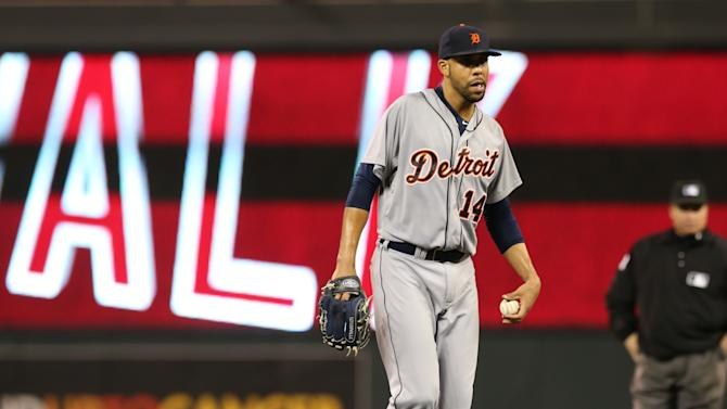 Detroit Tigers pitcher David Price gives up a walk to Minnesota Twins'  Aaron Hicks in the fourth inning of a baseball game, Wednesday, Sept. 17, 2014, in Minneapolis. (AP Photo/Jim Mone)