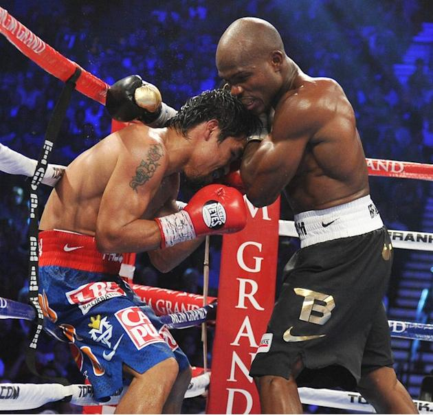 Timothy Bradley (R) Of The US Attempts AFP/Getty Images