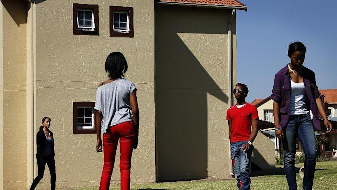 In this photograph shot Saturday May 19, 2012, fashion models rehearse in a Johannesburg, South Africa residential neighborhood  for the Soweto  Fashion Week scheduled to start Thursday May 24, 2012. Designers and entrepreneurs who have gotten together to put on a fashion show in Soweto are inspired by the famed township's creativity and history.(AP Photo/Jerome Delay)