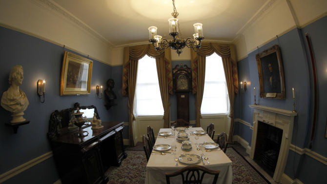 """The dining room of Charles Dickens' home, part of the Charles Dickens Museum in London, Wednesday, Dec. 5, 2012. For years, the four-story brick row house where the author lived with his young family was a dusty and slightly neglected museum, a mecca for Dickens scholars but overlooked by most visitors to London. Now, after a 3 million pound ($4.8 million) makeover, it has been restored to bring the writer's world to life. Its director says it aims to look """"as if Dickens had just stepped out."""" (AP Photo/Sang Tan)"""