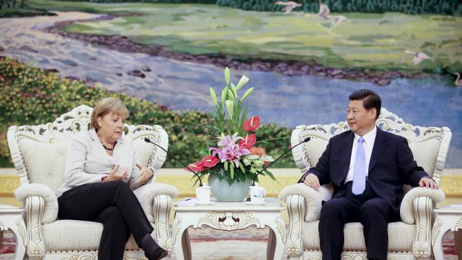 FILE - In this Aug. 30, 2012 file photo, Chinese Vice President Xi Jinping, right, listens to German Chancellor Angela Merkel during their meeting at the Great Hall of the People in Beijing, China. Where is President-in-waiting Xi Jinping? Chinese micro-bloggers and overseas websites have come up with all kinds of creative speculation as to why vice president Xi has gone unseen for more than a week. During that span, Xi canceled meetings in Beijing with visiting U.S. Secretary of State Hillary Clinton and Singapore Prime Minister Lee Hsien Loong. Monday, Sept. 10, it was the Danish prime minister's turn. (AP Photo/Diego Azubel, Pool, File)