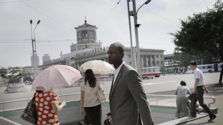 Two-time Grammy award winning rapper and a founding member of the Fugees, Pras Michel, poses for a picture, Sunday, Aug. 31, 2014 in downtown Pyongyang, North Korea. The American rapper and documentary filmmaker said he wanted to join in the immensely popular charity challenge and thought of Pyongyang where the ice bucket craze is unknown, would be the perfect place to do it. (AP Photo/Wong Maye-E)