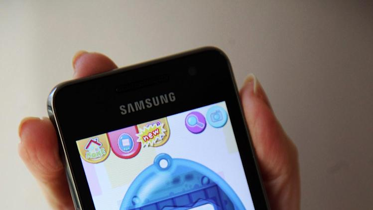 """The mobile app """"Tamagotchi L.I.F.E."""" by developer/publisher Bandai Co./Sync Beatz Entertainment is shown displayed on a smartphone on Wednesday, Feb. 13, 2013, in Los Angeles. (AP Photo/Richard Vogel)"""