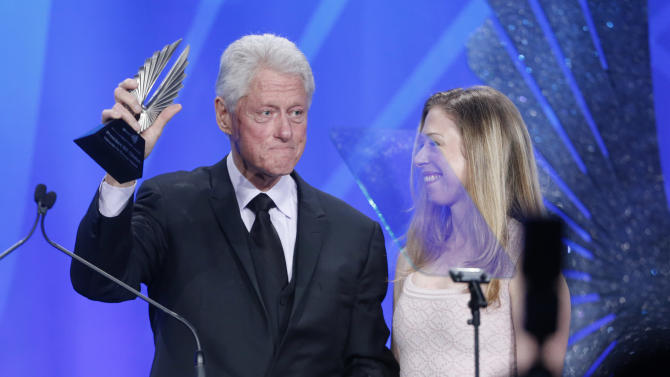 Former President of the United States Bill Clinton and Chelsea Clinton accept the Advocate for Change Award onstage at the 24th Annual GLAAD Media Awards at the JW Marriott on Saturday, April 20, 2013 in Los Angeles. (Photo by Todd Williamson/Invision/AP)