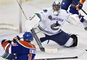 Tanev's OT goal lifts Canucks to win over Oilers
