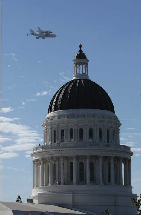 The space shuttle Endeavour passes over the California state Capitol, Friday, Sept. 21, 2012,  in Sacramento, Calif. Endeavour is making a final trek across the country to the California Science Cente