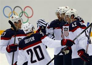 Team USA's Backes is congratulated by teammates after scoring a goal against Czech Republic during the first period of their men's quarter-finals ice hockey game at the 2014 Sochi Winter Olympic Games