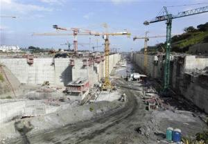 Workers and cranes are seen at the construction site of the Panama Canal Expansion project on the outskirts of Colon City