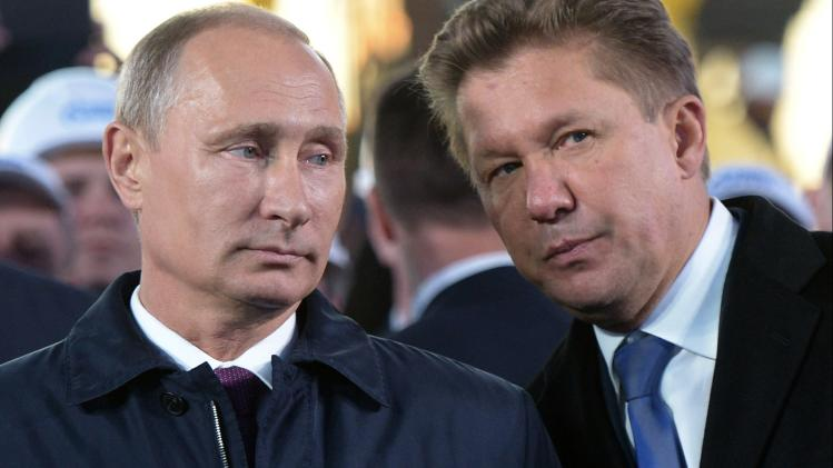 "Russian President Vladimir Putin, left, listens to Alexei Miller, CEO of Russian natural gas giant Gazprom during the ceremony marking the construction of gas pipeline ""Power of Siberia"" connecting Russia and China near the village of Us Khatyn in Yakutsk region, Russia, Monday, Sept. 1, 2014. (AP Photo/RIA Novosti, Alexei Nikolsky, Presidential Press Service)"