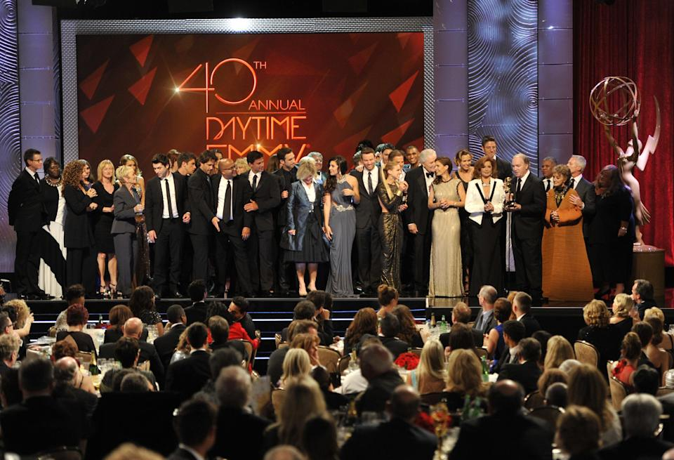 "The cast and crew of ""Days of Our Lives"" accept the award for outstanding drama series at the 40th Annual Daytime Emmy Awards on Sunday, June 16, 2013, in Beverly Hills, Calif. (Photo by Chris Pizzello/Invision/AP)"