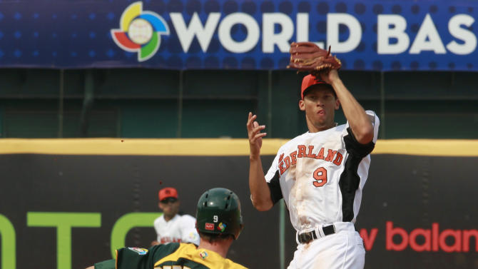 Australia's shortstop James Beresford slides into second as the Netherlands' shortstop Andrelton Simmons, right, prepares for a double play in the sixth inning of their World Baseball Classic first round game at the Intercontinental Baseball Stadium in Taichung, Taiwan, Tuesday, March 5, 2013. The Netherlands won 4-1. (AP Photo/Wally Santana)