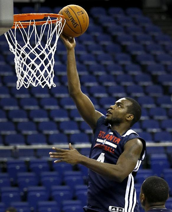Atlanta Hawks player Paul Millsap attends a training session at the O2 Arena in London, Wednesday, Jan. 15, 2014. The Atlanta Hawks will play the Brooklyn Nets in an NBA match at the O2 Arena on Thurs