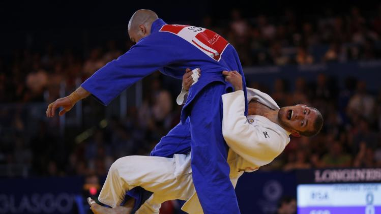 Zak Piontek of South Africa competes against Matthew Purssey of Scotland during the judo -90kg gold medal contest at the 2014 Commonwealth Games in Glasgow