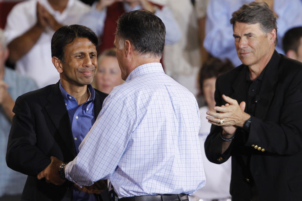 Republican presidential candidate and former Massachusetts Gov. Mitt Romney greets Louisiana Gov. Bobby Jindal as Texas Gov. Rick Perry is at right as he campaigns at Basalt Public High School, in Basalt, Colo., Thursday, Aug. 2, 2012, en route to Aspen, Colo. (AP Photo/Charles Dharapak)