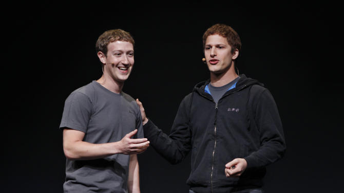 "Facebook CEO Mark Zuckerberg, left, and comedian Adam Samberg, right, smile during the f/8 conference in San Francisco, Thursday, Sept. 22, 2011. Facebook is dramatically redesigning its users' profile pages to create what CEO Mark Zuckerberg says is a ""new way to express who you are."" (AP Photo/Paul Sakuma)"