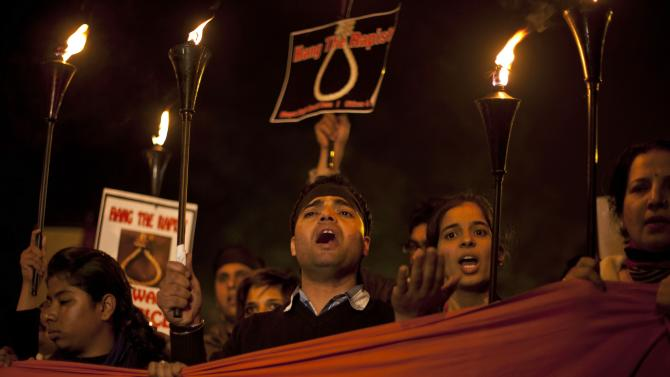 Indians shout slogans and march on a street as they mourn the death of a gang rape victim in New Delhi, India, Saturday, Dec. 29, 2012. Indian police charged six men with murder on Saturday, adding to accusations that they beat and gang-raped the woman on a New Delhi bus nearly two weeks ago in a case that shocked the country. The murder charges were laid after the woman died earlier Saturday in a Singapore hospital where she has been flown for treatment.(AP Photo/ Dar Yasin)