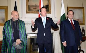 British PM David Cameron (C), Afghan President Hamid …