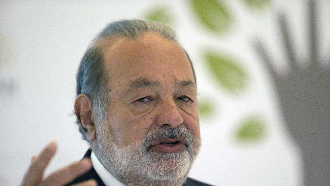FILE- Mexican telecommunications tycoon Carlos Slim speaks during news conference in Mexico City, in this file photo dated Monday, Jan. 14, 2013. It is announced Friday March 22, 2013, that America Movil Mexican telecommunications company controlled by Mexican magnate Carlos Slim, the world's richest man, has secured the rights to next year's Winter Games in Sochi, Russia, and the 2016 Summer Olympics in Rio de Janeiro on all media platforms across Latin America. (AP Photo/Dario Lopez-Mills, File)