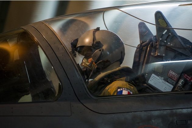This picture released by the French Army Communications Audiovisual office (ECPAD) shows French fighter pilot getting ready to take off with a Mirage 2000 D, at Kossei camp in N'Djamena, Chad, Friday,