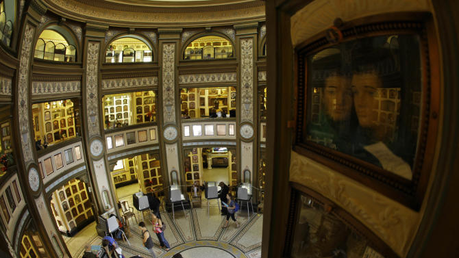 People wait in line to vote at the Neptune Society Columbarium Tuesday, Nov. 6, 2012 in San Francisco. Built in 1898, the Neo-Classical columbarium is one of the last remaining cemeteries in San Francisco. (AP Photo/Eric Risberg)