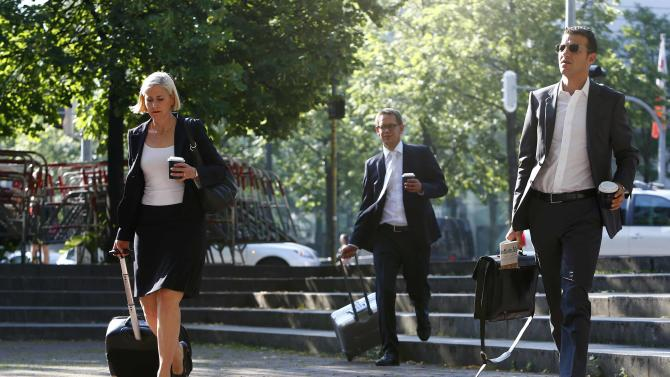Lawyers Sturm Heer and Stahl of defendant Beate Zschaepe arrive for continuation of their client's trial in Munich
