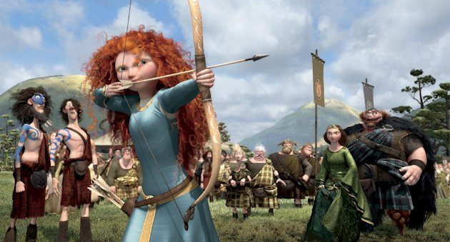 This film image released by Disney/Pixar shows the character Merida, voiced by Kelly Macdonald, in a scene from &quot;Brave.&quot; The top spot at the box office is rare turf for Kelly Macdonald, a character actress known on the big-screen mainly for supporting roles in such films as &quot;No Country for Old Men&quot; and &quot;Finding Neverland.&quot; With her wild red mane and her killer skills with sword and bow, Macdonald has become the latest in Hollywood&#39;s growing line of successful female action heroes. (AP Photo/Disney/Pixar)