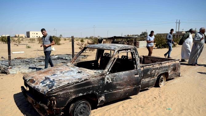 File picture shows the wreckage of a burnt down car, the day after an attack by the Egyptian army in a village on the outskirt of the northern Sinai town of Sheik Zuweid on September 10, 2013