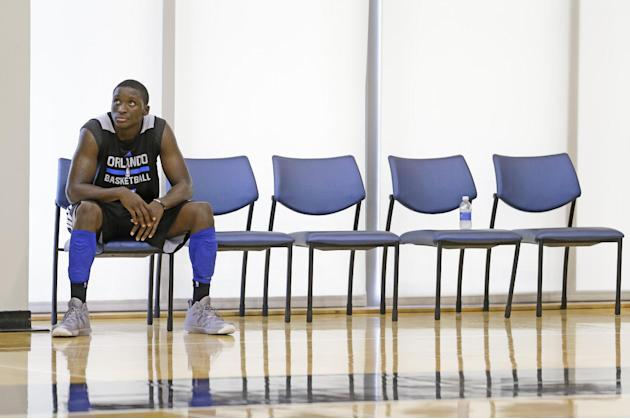 Orlando Magic's Victor Oladipo takes a break at NBA basketball training camp, Tuesday, Oct. 1, 2013, in Orlando, Fla